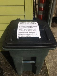 "A single ""accessible"" garbage bin"